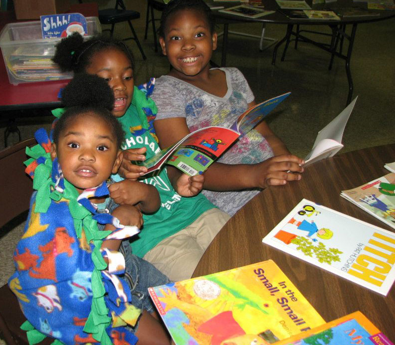 A family snuggles up and reads at EnjoyReading's Winter 2012 Family Literacy Night at Stanton Elementary School.