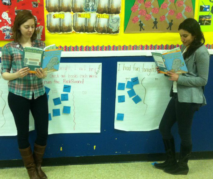 EnjoyReading founders Rachel Scheer and Ali Hoffman enjoy a book by one of their favorite authors, Mo Willems, at Stanton Elementary.