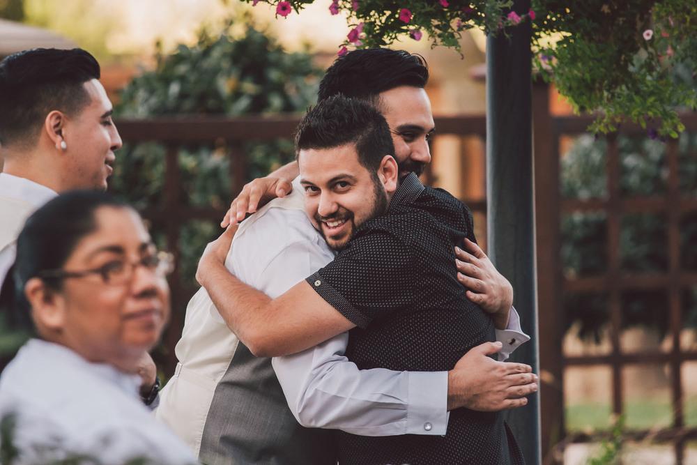 groomsmen hug