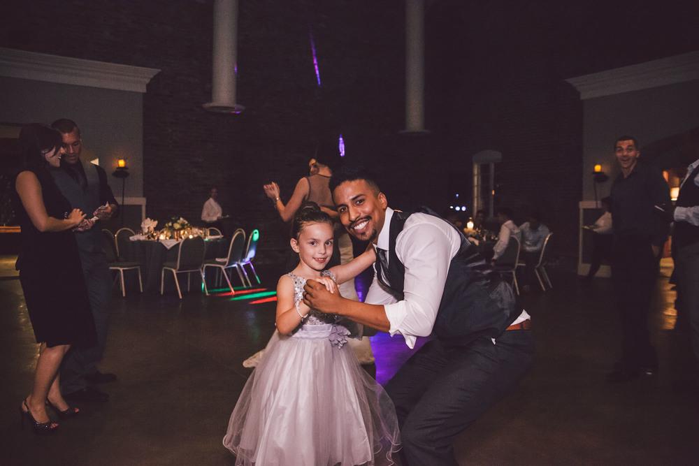 groom flower girl dance