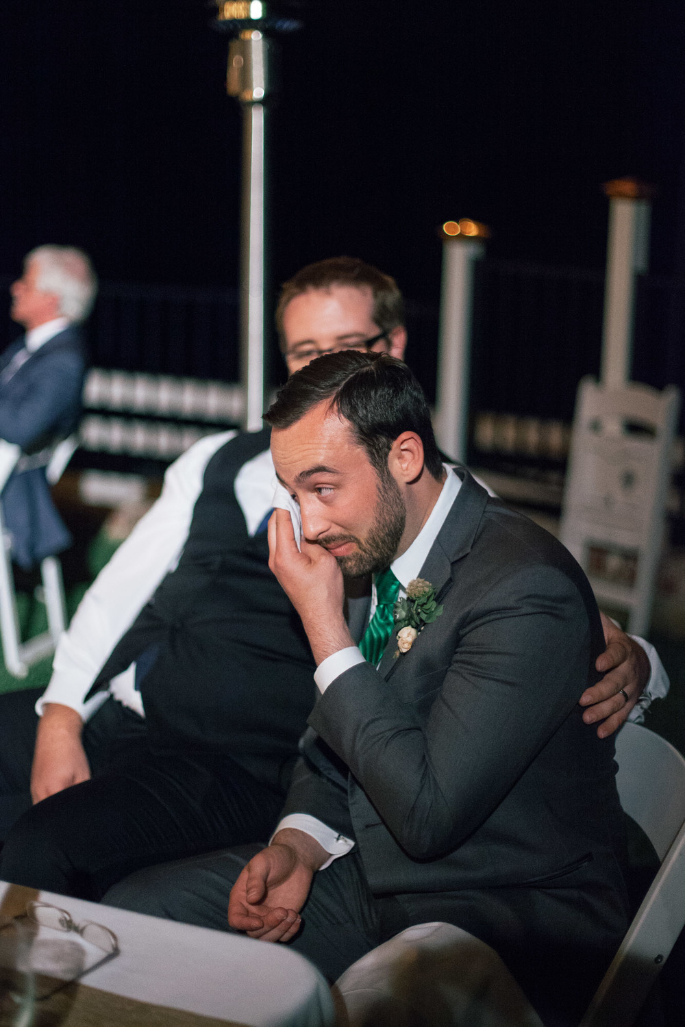 best man consoling groom