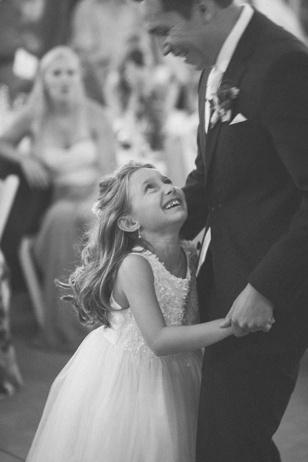 groom and flower girl dance