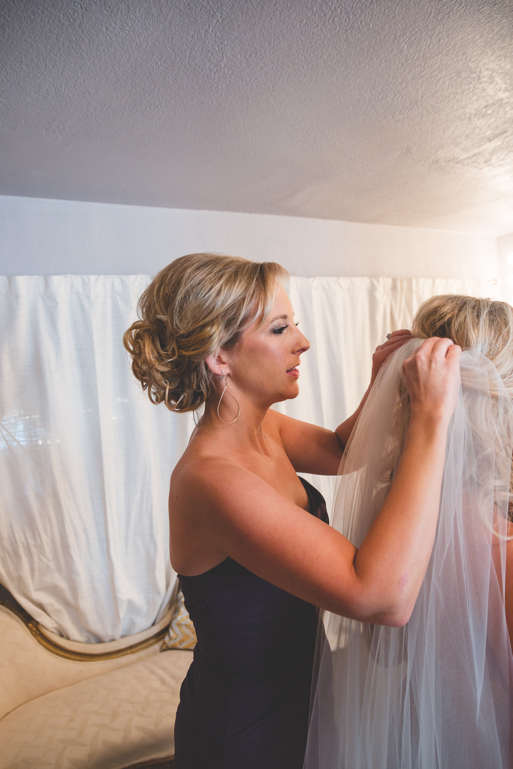 sister putting on veil