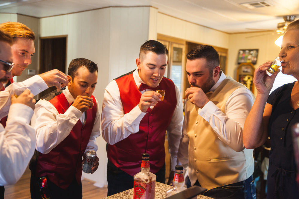 groomsmen taking shots