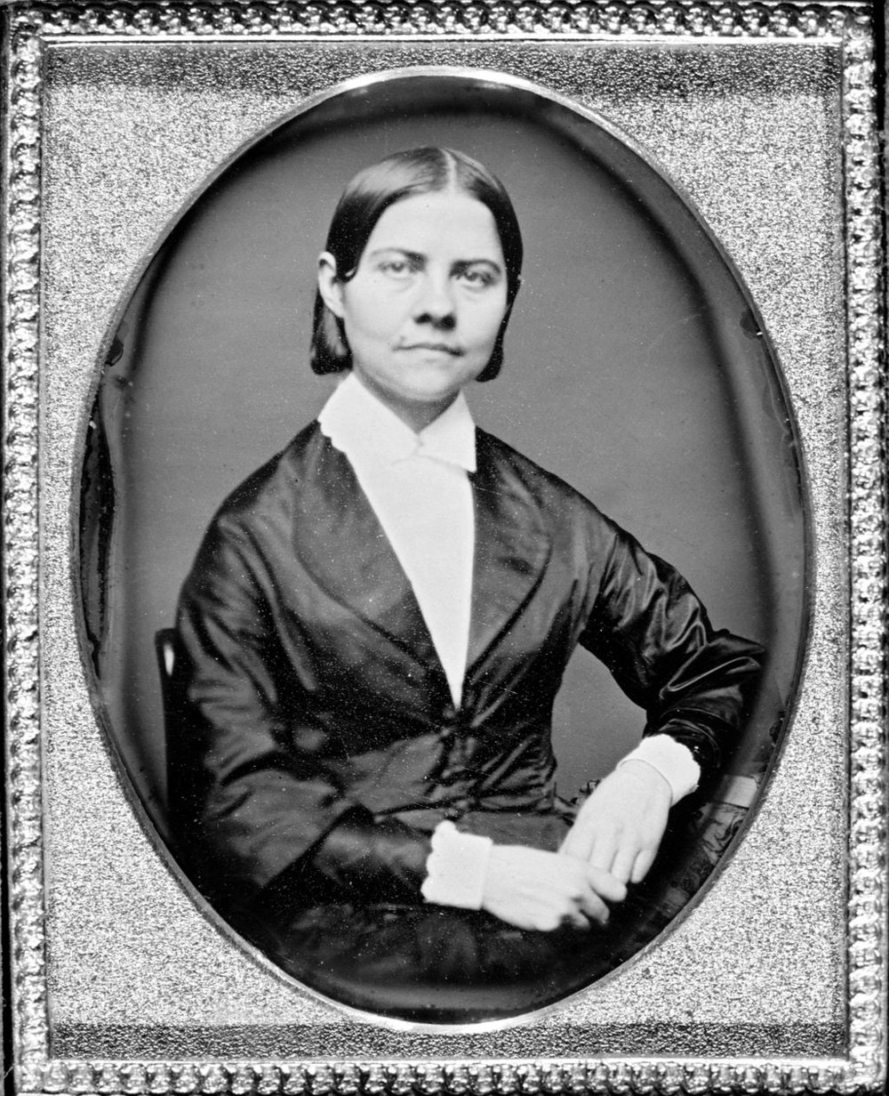 Lucy Stone (1818-1893), prominent women's suffragist and abolitionist. She became the first woman from Massachusetts to earn a college degree and was an active public advocate on behalf of women's rights and anti-slavery initiatives. Stone pursued her advocacy despite often hostile laws of the time preventing women from speaking in public.