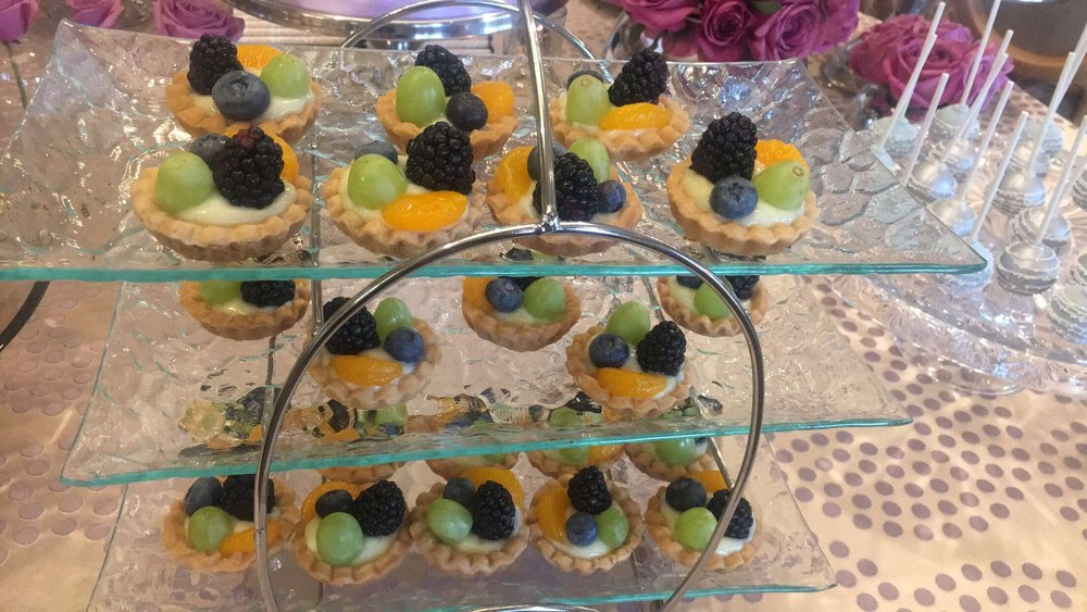 Fresh Fruit Tartlets - Seasonal fruit atop Vanilla Pastry cream in a buttery shortbread shell.