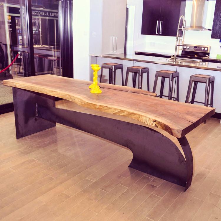 Live edge black walnut dining table on a designer base