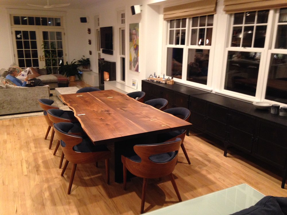 Black walnut dining table with brass butterflies