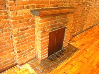 3. decorative fireplace, brick, orig. floor.jpg