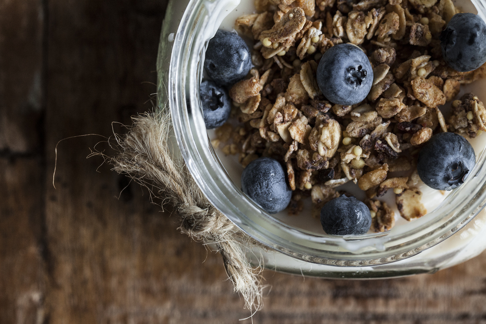 yogurt, granola clusters, and fresh blueberries