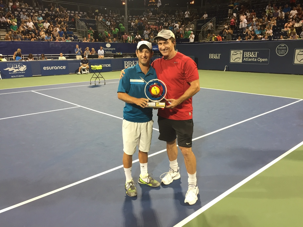 CONGRATULATIONS TO SCOTT GATES, THE 2015 SIGNATURE TENNIS SHARP SHOOTER CHAMPION! SCOTT IS PICTURED AFTER HIS BIG WIN AT THE 2015 BB&T ATLANTA OPEN WITH MIKE IMBORNONE OF SIGNATURE TENNIS COURTS. SCOTT IS A MEMBER OF THE GPTA BOARD OF DIRECTORS AND THE TENNIS STAFF AT DUNWOODY COUNTRY CLUB. CONGRATULATIONS!