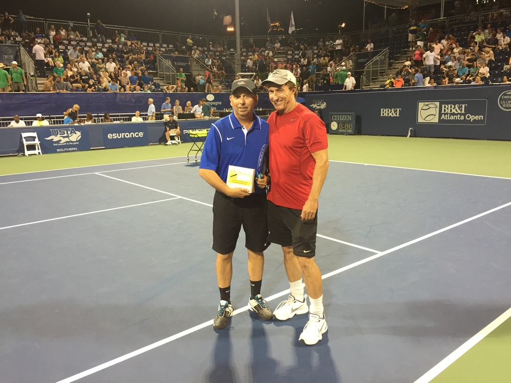 CONGRATULATIONS TO ALLAN JENSEN FOR TAKING HOME THE SECOND-PLACE AWARD IN THE SIGNATURE TENNIS SHARP SHOOTER CHAMPIONSHIP! ALLAN IS PICTURED WITH MIKE IMBORNONE OF SIGNATURE TENNIS COURTS.