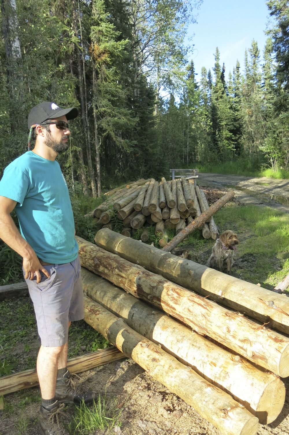 Nick and the logs for the new cabin.