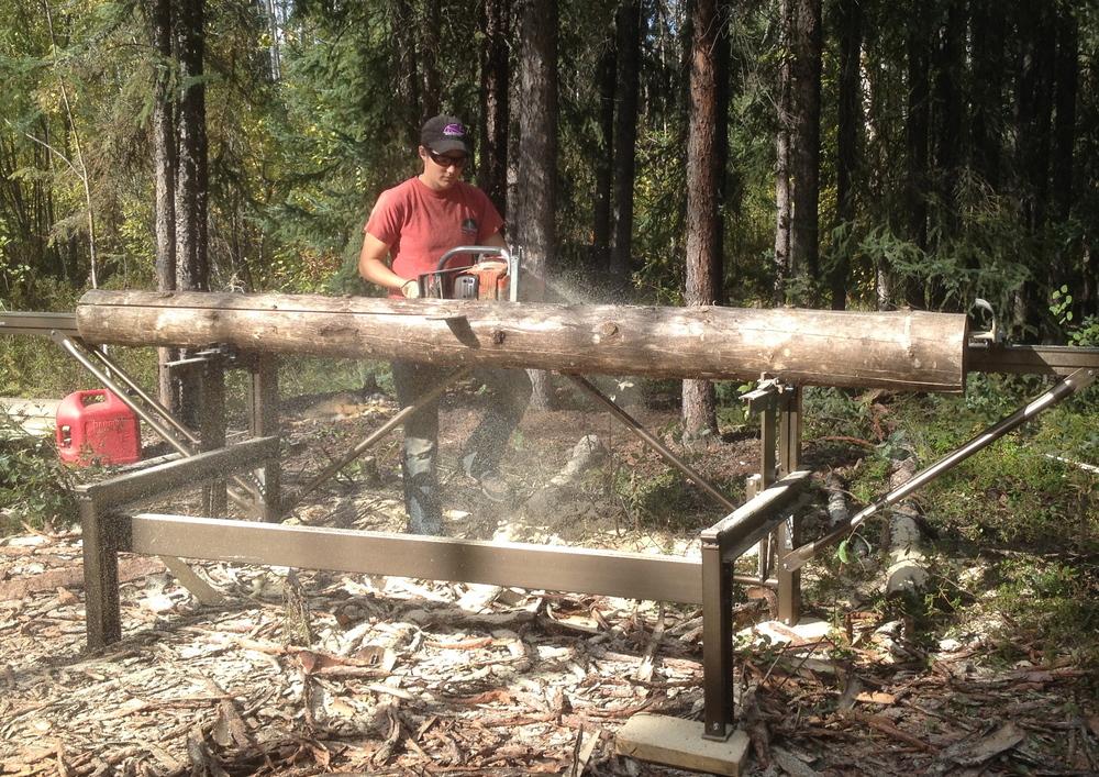 Ryne milling a log.