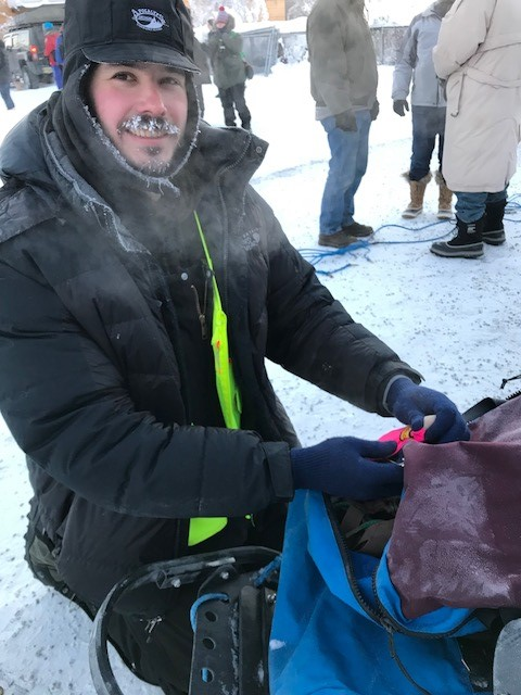 Allan, a Quest volunteer, mounting the trackers on the sled.