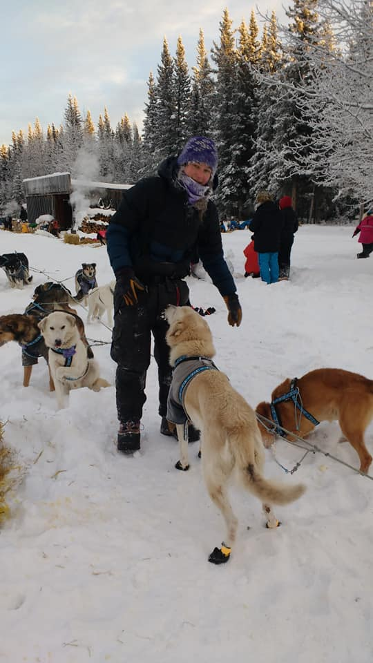 Ryne taking care of her dogs just after arriving at the first checkpoint.