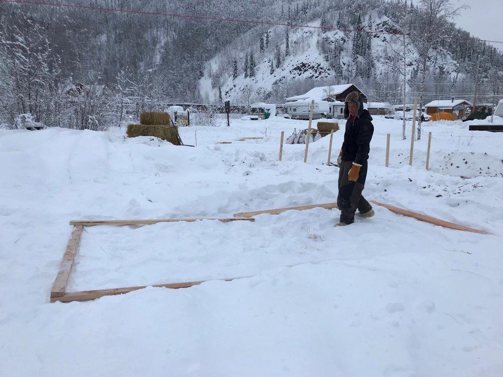 Derek building the base for dog tent