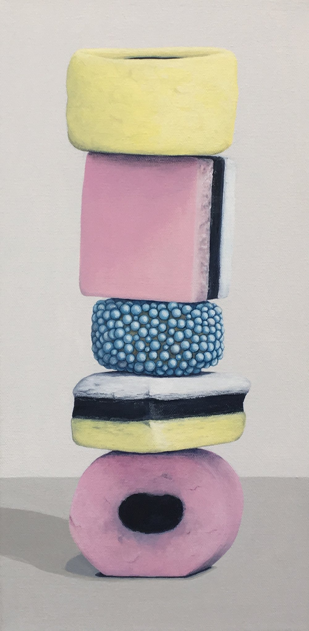 "Totem: Allsorts II   This enticing candy stacks is a delightful temptation. As a culture we are generally attracted to these charming colors and interesting shapes, but once the candy is experienced as a food there is often a mismatch between its attractiveness and its taste. This work explores the occurrence of the incongruity of appearance and experience.  8"" x 16"" gallery wrapped canvas  $400.00"