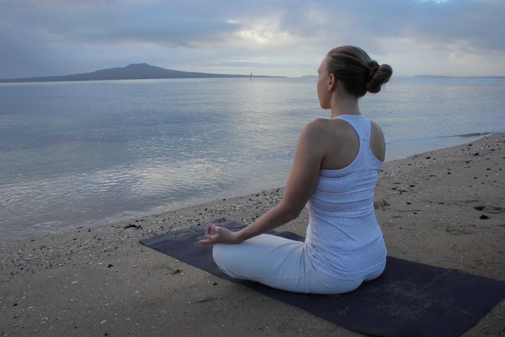 Erin enjoying blissful sunrise Yoga & Mediation on Takapuna Beach (April 2013)