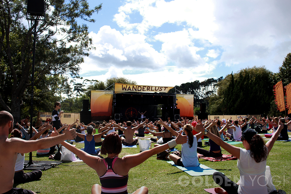 Erin sharing Kundalini Yoga on the mainstage at Wanderlust Auckland 2014, with over 1200 enthusiastic yoga fans.