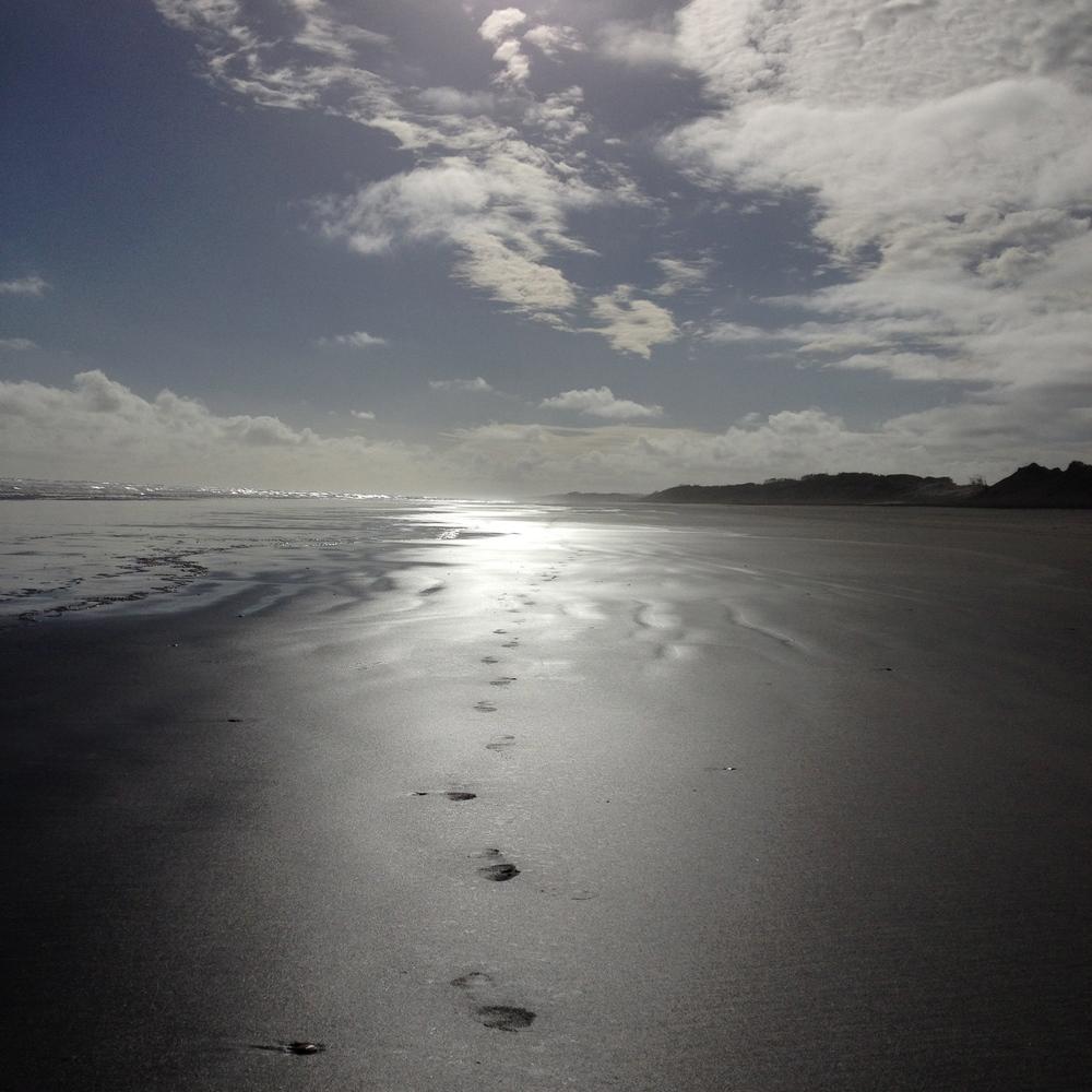 Footprints on the Sand Muriwai Beach Auckland yoga nz