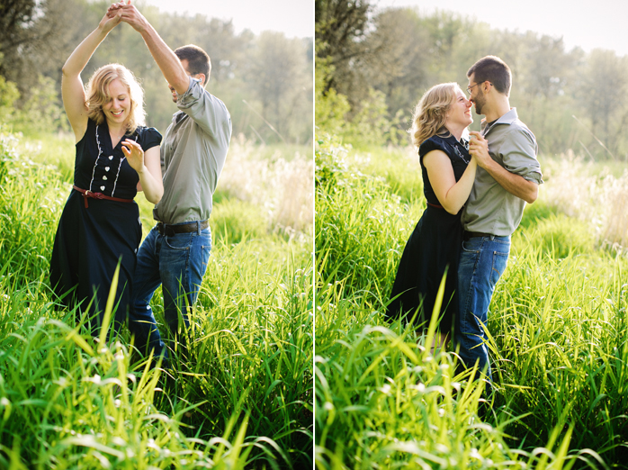 engaged couple dancing in the grass in portland oregon
