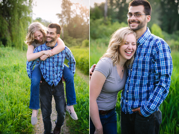 engaged couple piggy-back ride in grass