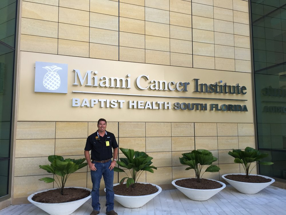 Miracle Fruit Farm owner and CEO Erik Tietig at the grand opening of MCI's new building where for the first time Miracle Fruit is formally recommended and distributed in an oncology patient care program utilizing the farm's very own Miraculous™ tablets.