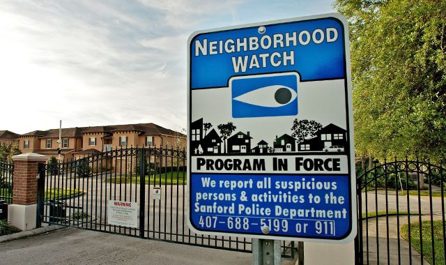 A Neighborhood Watch sign stands outside The Retreat at Twin Lakes gated community where Trayvon Martin was shot by George Michael Zimmerman.  (Photo by Roberto Gonzalez/Getty Images)