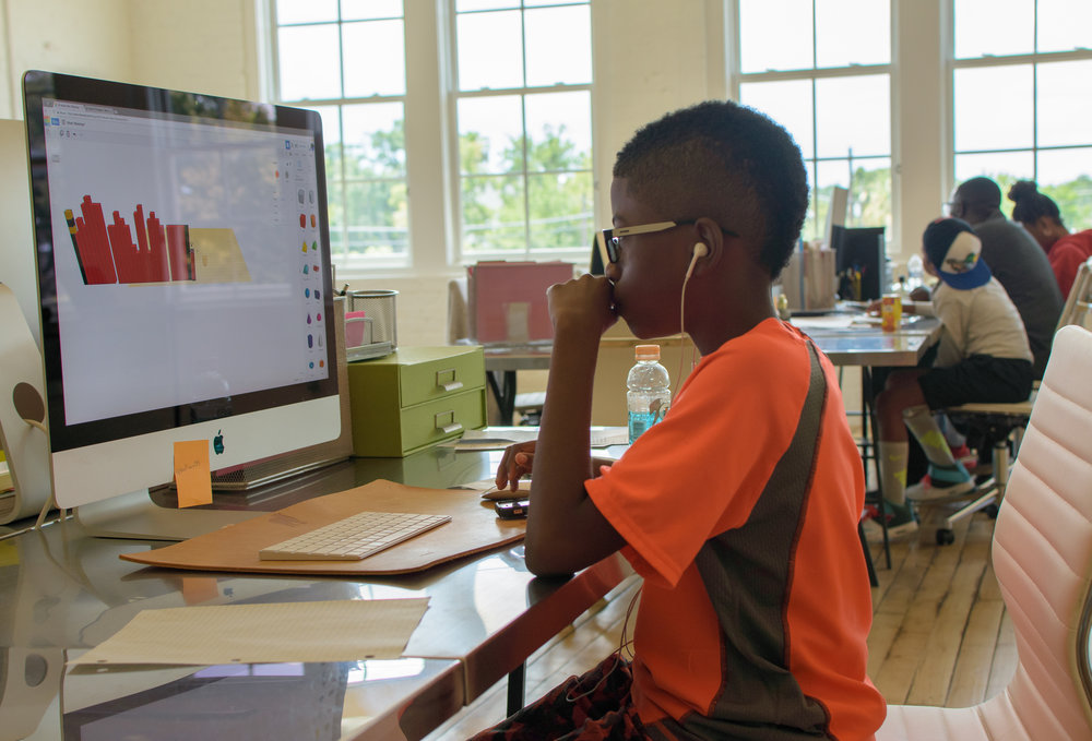 Houston Hip Hop Architecture Camp participant uses Autodesk Tinkercad.