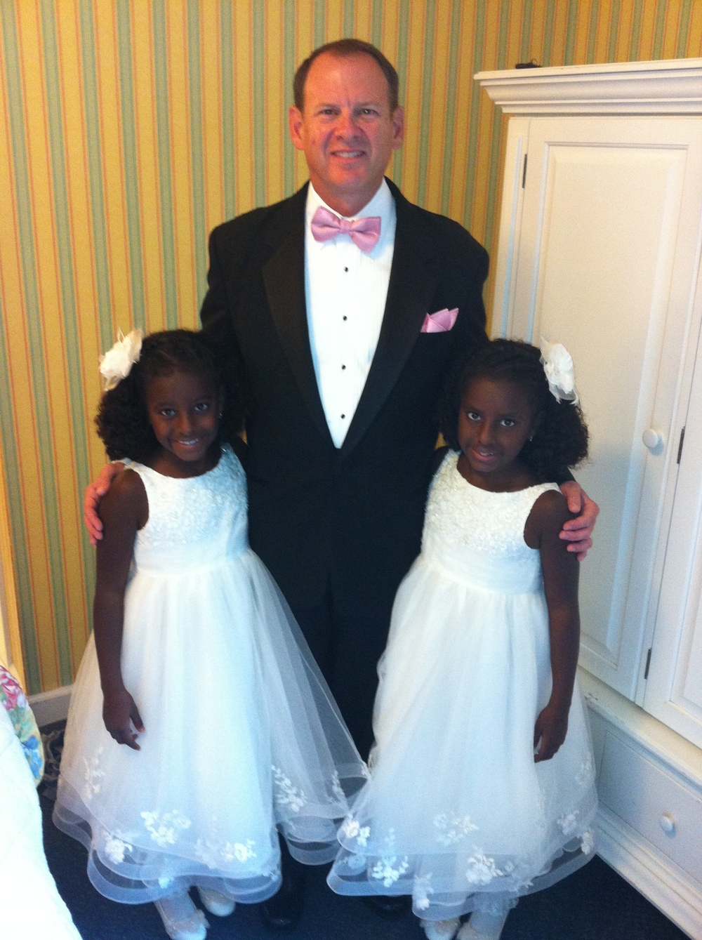 Twins Candace (L) and Sarah (R) in the summer of 2013 when they were flower girls.