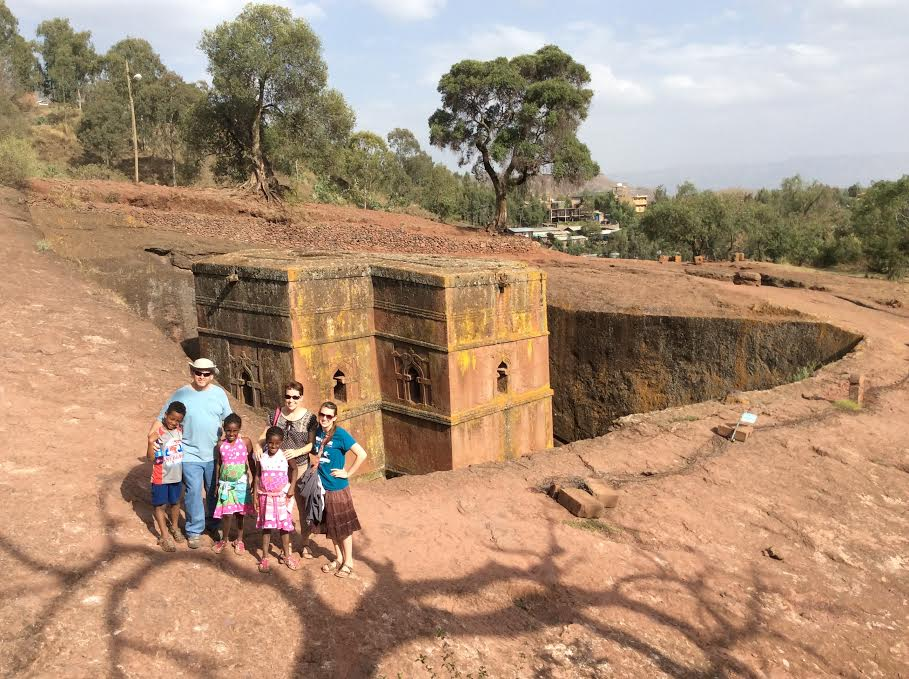 A picture of the real Ethiopia, with St Gyorgis Church behind some of the Spears clan.  This church is one of several in the city of Lilibela, and a World Heritage Site.