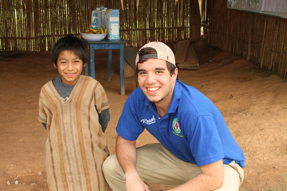 Oliver with Roberto, a little boy in the village.