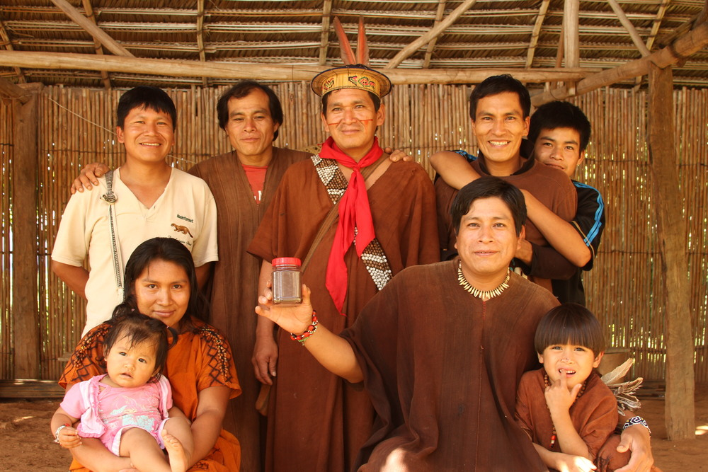 The Asháninka people of San Miguel showing off a small jar of their Specialty-grade coffee.