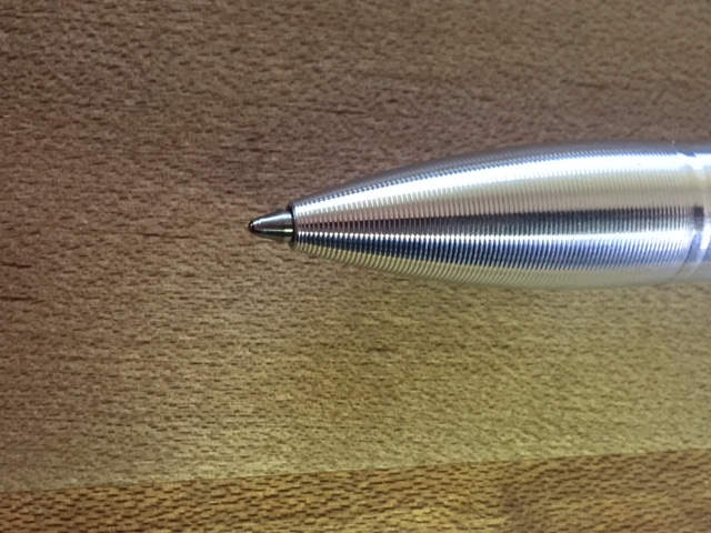 When the Jetstream has been modified to the proper length put it back in the pen and screw it together. When the pen is in the advanced position the refill should stick out this far.
