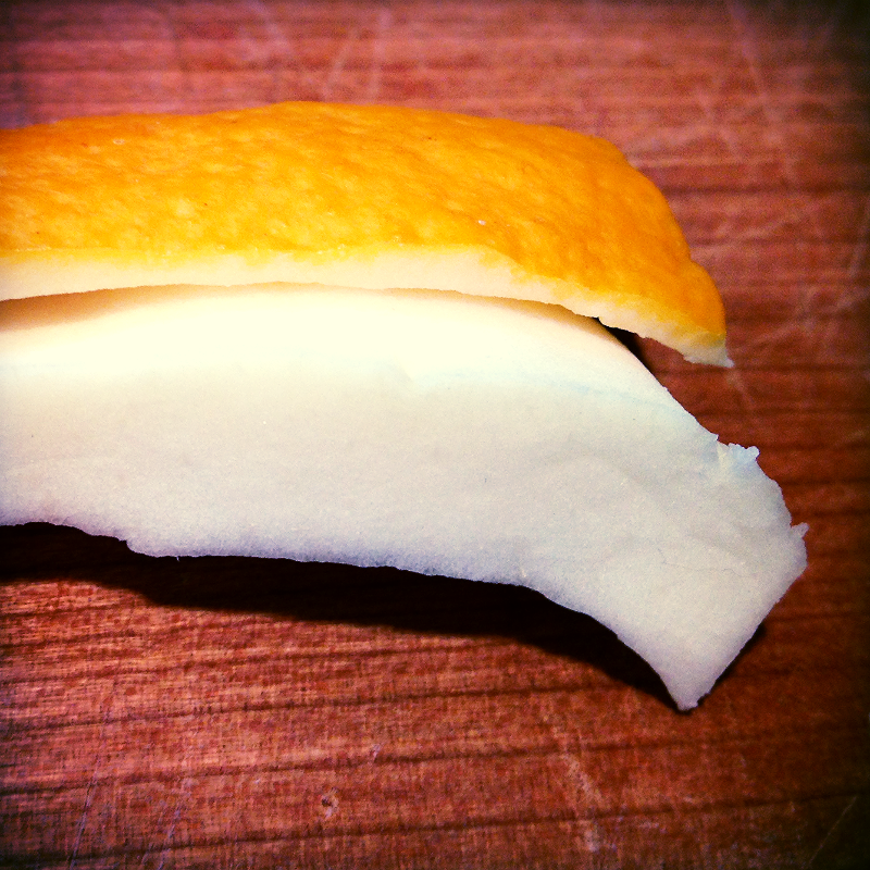 The thick white rind did not want to separate from the peel.