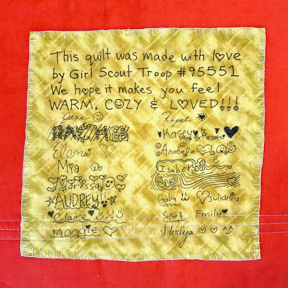 The troop decided what the quilt label would say, and then each signed their names.