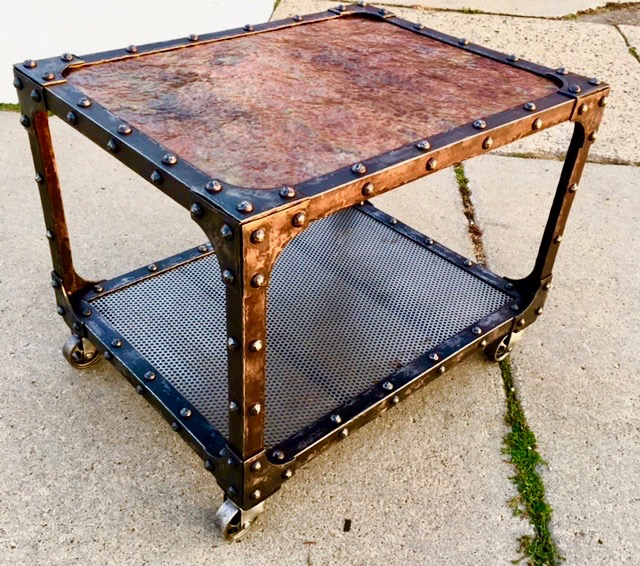 Hammered copper top, textured angle iron frame, perforated steel shelf & hand forged rivets, vintage casters... oil & wax.