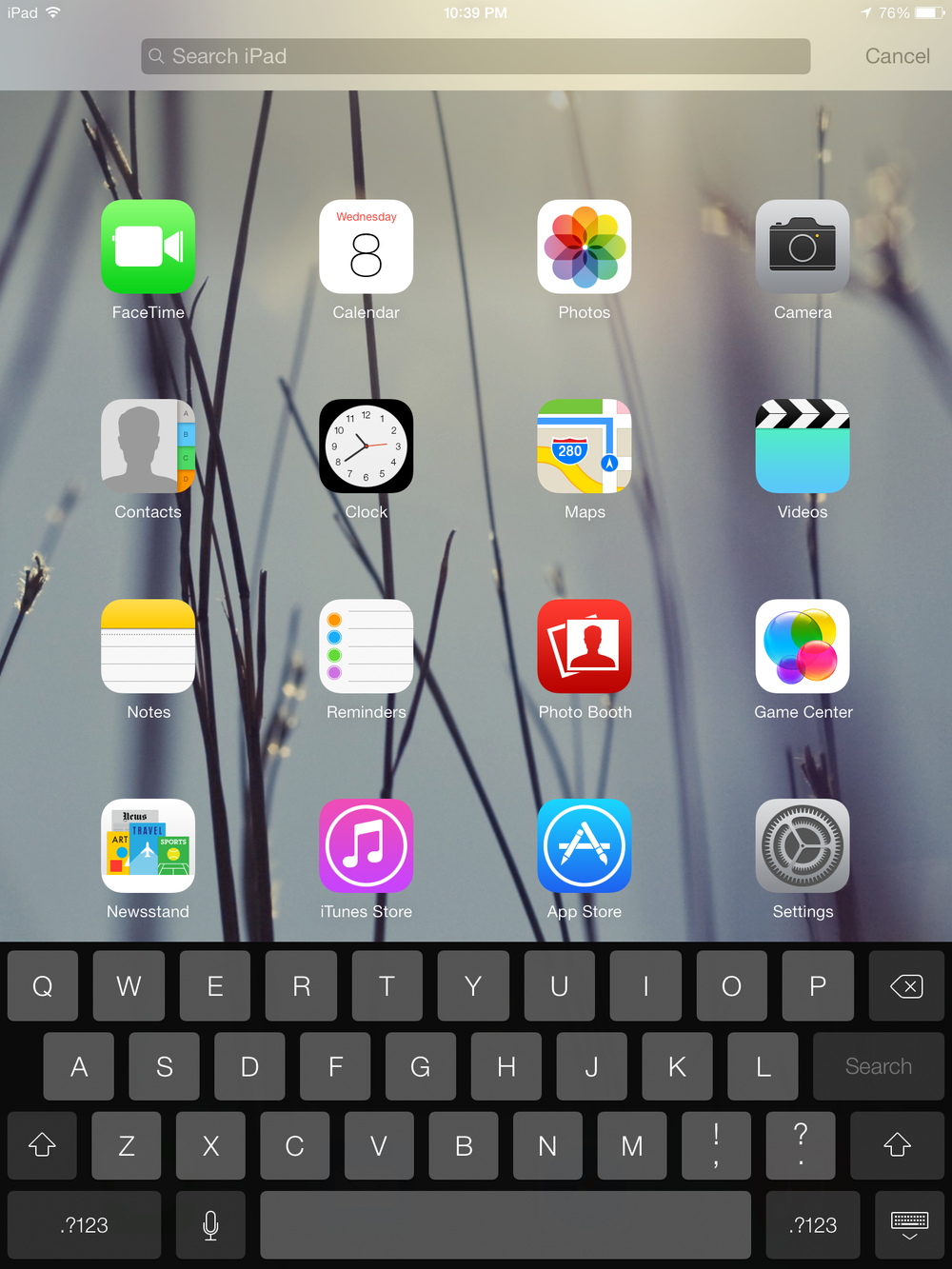 Apple has changed the access point for Spotlight. Users now must swipe down with one finger on any home screen to access it. Though the placement has changed, the effect is much more subtle. The search bar is more Android-like. The darker themed keyboard more closely resembles the Google's