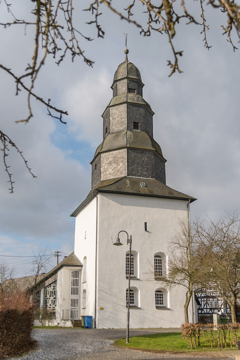 One of Holzhausen's most unique and recognizable structures, the state church's octagonal, slate-shingled steeple rises in the heart of the old town center.