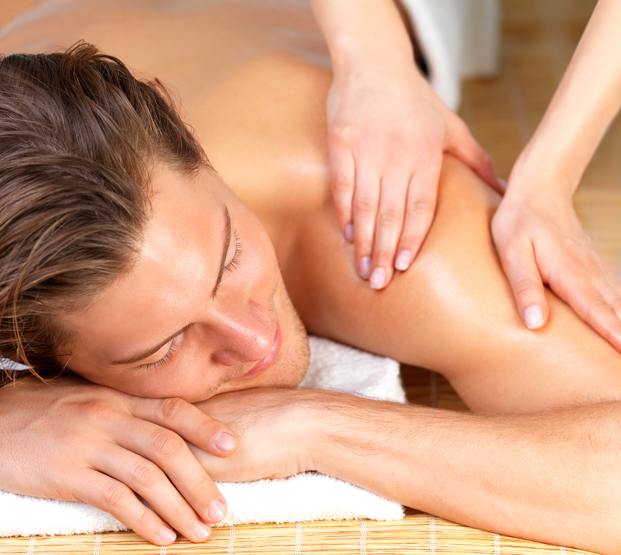 bigstock-Happy-Man-Getting-Massage-At-S-6228598.jpg