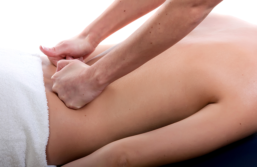 bigstock-Massage-therapist-doing-a-back-11920160.jpg