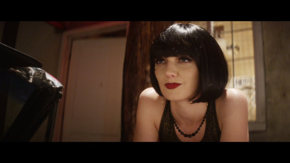 Hannah Levien as Vanity
