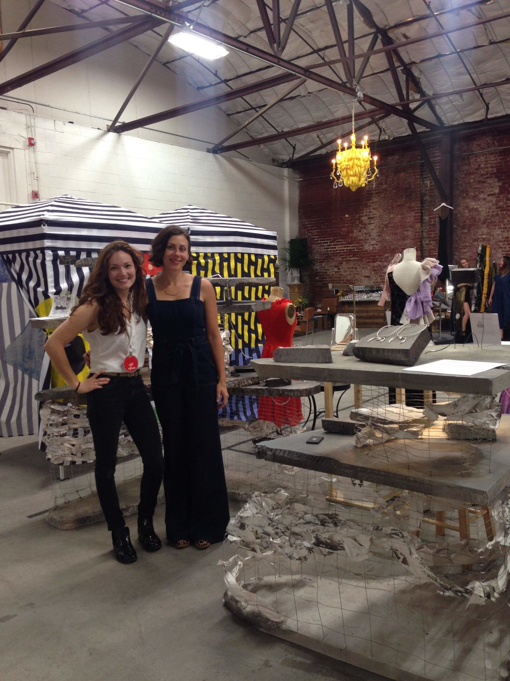 Erin and me standing in front on the gorgeous installation at The Wardrobe Project in Nashville