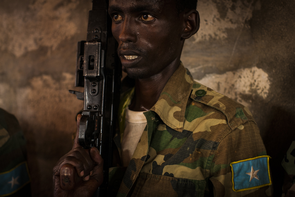 A soldier in the Somali National Army learns to clean, assemble, and load a gun at the European Union's Jazeera Training Camp in Mogadishu, Somalia, May 1, 2014.