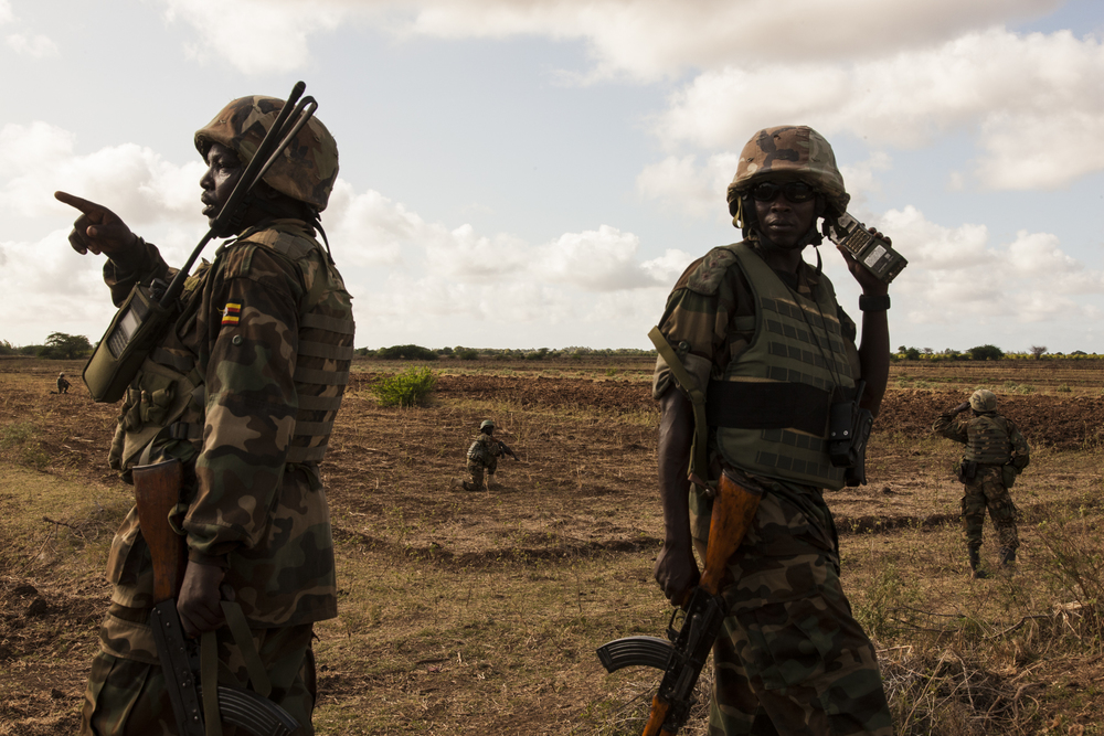 "Ugandan soldiers on patrol outside of the town of Qoryooley, which was taken from al Shabaab during ""Operation Eagle"", the first joint military offensive with the Somali National Army, in Lower Shabelle, Somalia, April 29, 2014."