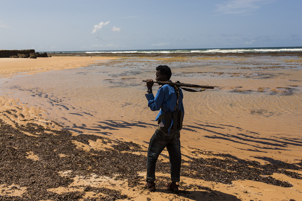 A member of a local clan-based militia is seen along the coast, just south of Merca. The group was formed as an alternative to the Somali National Army which they say has not only failed to protect the community from al Shabaab, but also supports pro-government militias in Lower Shabelle, Somalia, April 30, 2014.