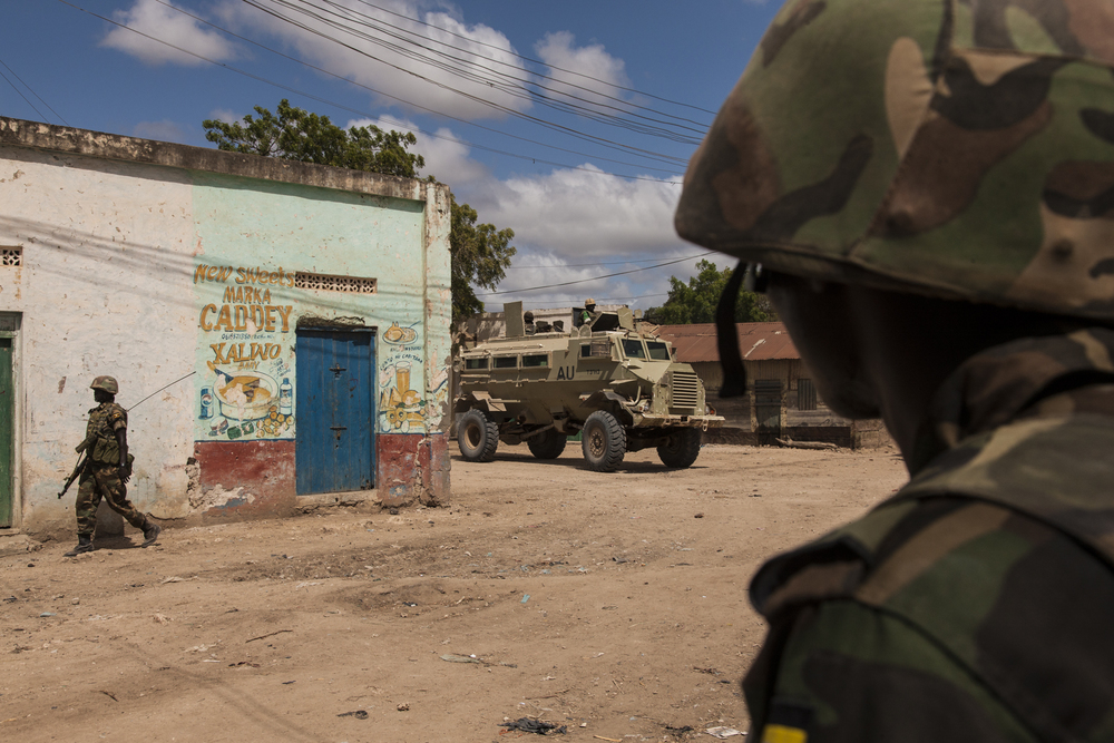 Ugandan AMISOM soldiers patrol the town of Qoryooley, which was taken from al-Shabaab during the most recent offensive, Operation Eagle, in Lower Shabelle, Somalia, April 29, 2014.