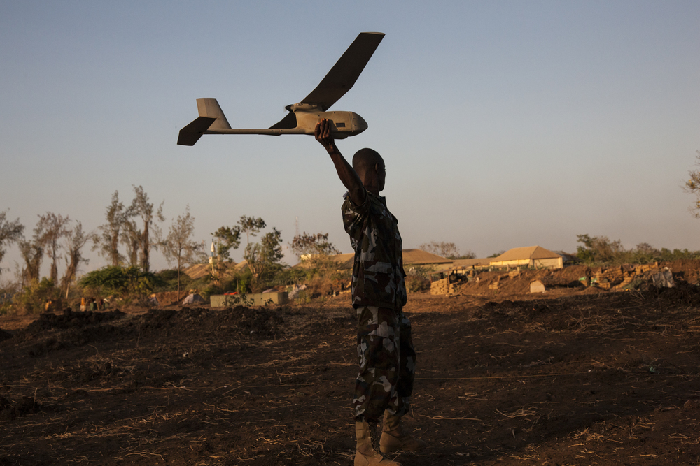 In order to track the movement of al Shabaab, a Ugandan soldier launches a surveillance drone from the military base in Qoryooley, Lower Shabelle, Somalia, April 29, 2014.