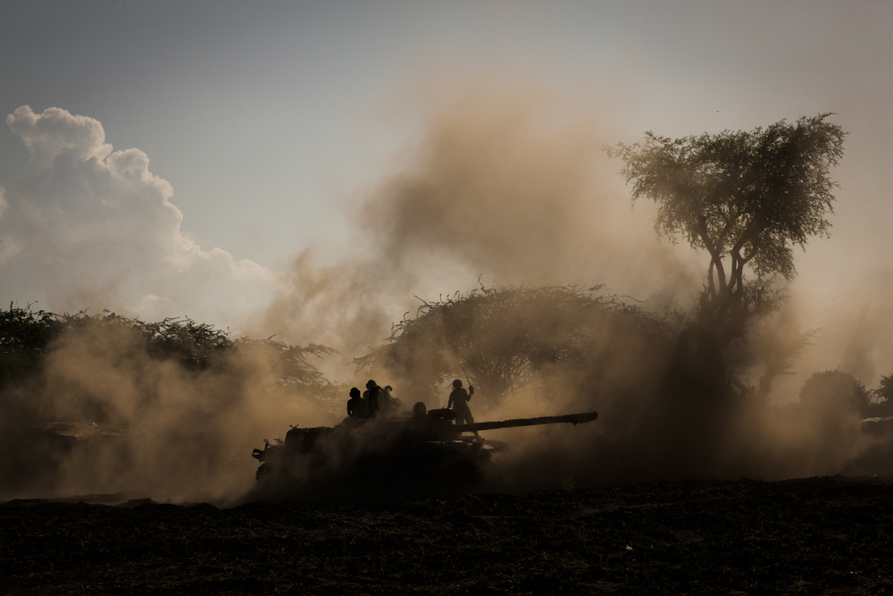 Ugandan soldiers return a tank to the military base after an evening patrol in the town of Qoryooley, Lower Shabelle, Somalia, April 28, 2014.